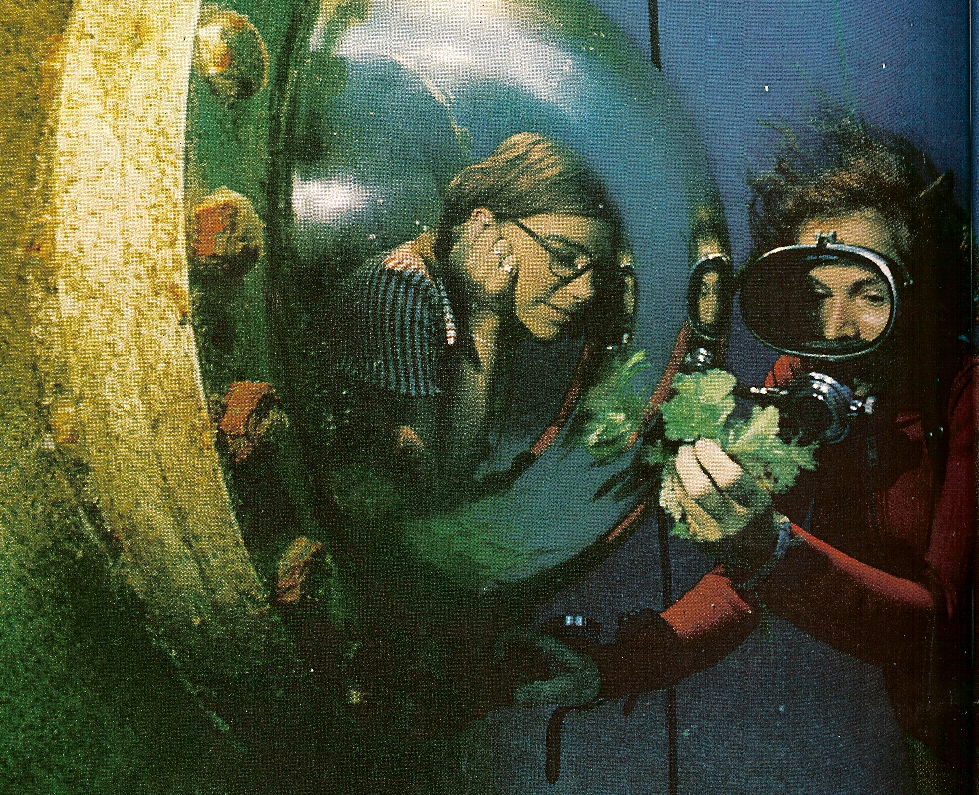 Peggy Lucas inside the Tektite Habitat observes diver Sylvia Earle (c.1970). Photo Credit: Exploring The Deep Frontier by Sylvia Earle and Al Giddings.